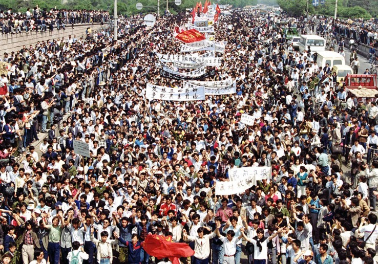 Thousands of students from local colleges and universities march to Tiananmen Square, Beijing, on May 4, 1989, to demonstrate for government reform. (AP Photo/Mikami)